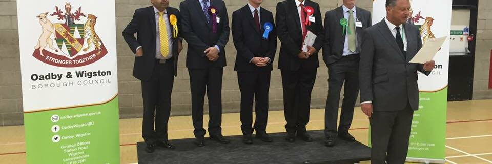Acting Returning Officer, Mark Hall, announcing the new MP for the Harborough constituency - Neil O'Brien (Conservative Party).