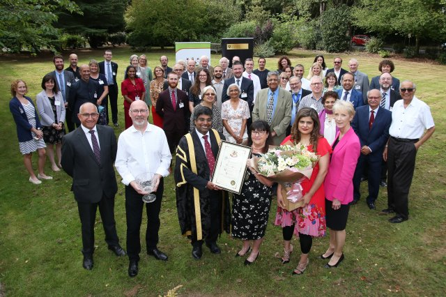 Group photo of councillors, representatives of the University and other guests celebrating the Freedom of the Borough conferral